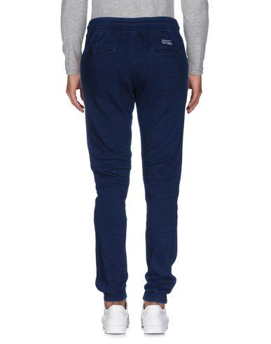 Фото 2 - Повседневные брюки от PUBLISH темно-синего цвета