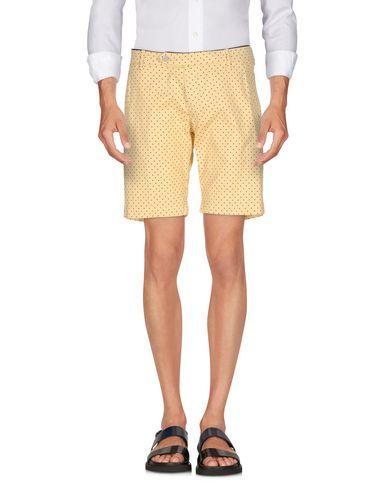 Купить Повседневные шорты от MICHAEL COAL желтого цвета