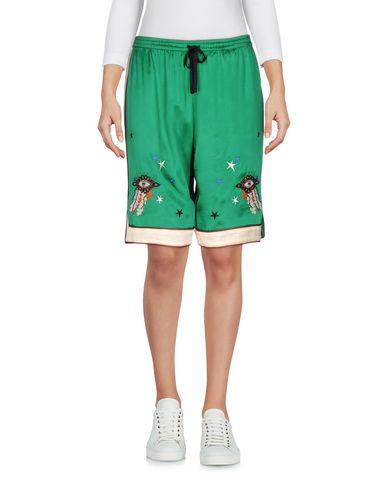 Фото - Женские бермуды  зеленого цвета