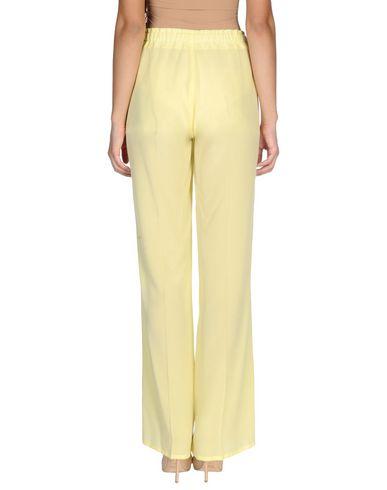 Фото 2 - Повседневные брюки от ERMANNO DI ERMANNO SCERVINO желтого цвета