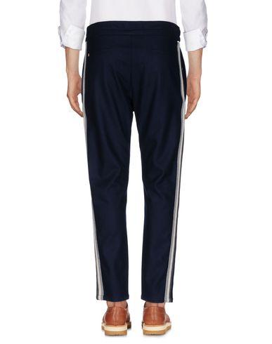 Фото 2 - Повседневные брюки от LOW BRAND темно-синего цвета