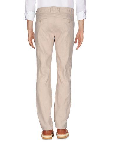 Фото 2 - Повседневные брюки от LIU •JO MAN бежевого цвета