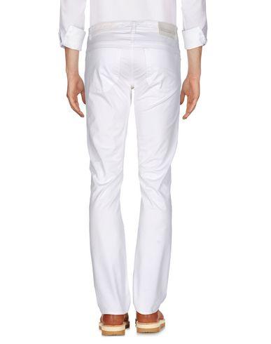 Фото 2 - Повседневные брюки от SIVIGLIA белого цвета