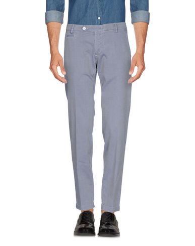 Фото - Повседневные брюки от MICHAEL COAL светло-серого цвета