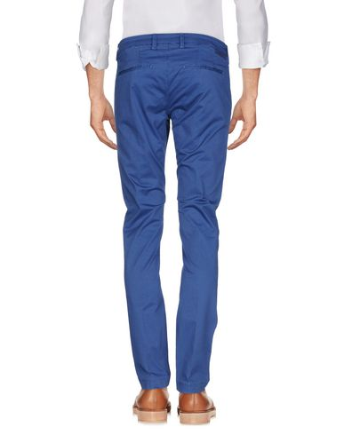 Фото 2 - Повседневные брюки от MICHAEL COAL пастельно-синего цвета