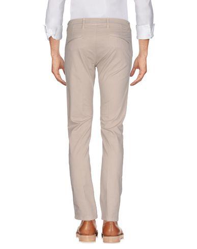 Фото 2 - Повседневные брюки от OUTFIT бежевого цвета