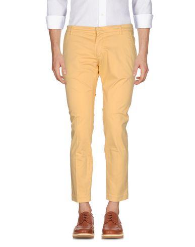 Фото - Повседневные брюки от MICHAEL COAL желтого цвета