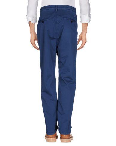 Фото 2 - Повседневные брюки темно-синего цвета
