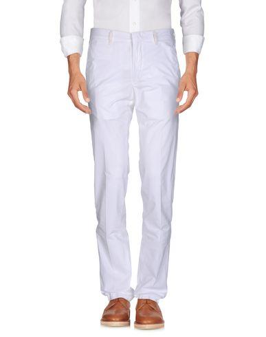 Фото - Повседневные брюки от THE GIGI белого цвета