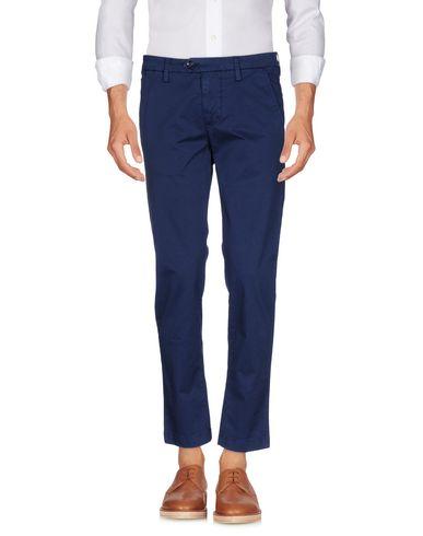 Фото - Повседневные брюки от DW FIVE темно-синего цвета