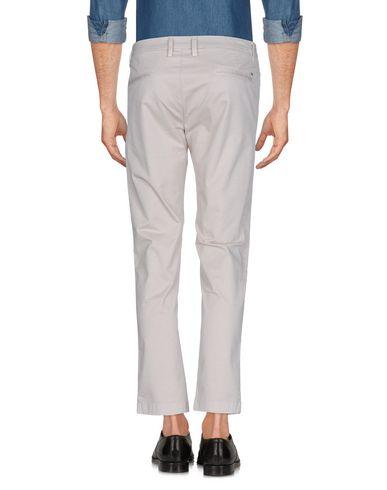 Фото 2 - Повседневные брюки от DW FIVE светло-серого цвета