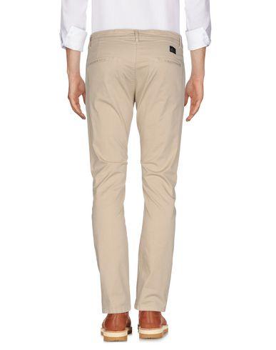 Фото 2 - Повседневные брюки бежевого цвета