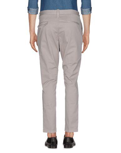 Фото 2 - Повседневные брюки от N° 4 FOUR серого цвета
