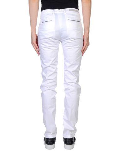 Фото 2 - Повседневные брюки от ELEVENTY белого цвета
