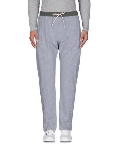 Купить Повседневные брюки от GAëLLE Paris светло-серого цвета