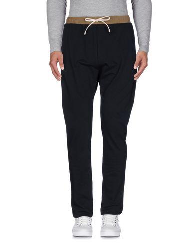 Фото - Повседневные брюки от GAëLLE Paris черного цвета