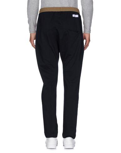 Фото 2 - Повседневные брюки от GAëLLE Paris черного цвета