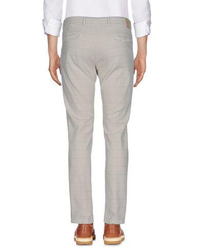 Фото 2 - Повседневные брюки от MICHAEL COAL бежевого цвета