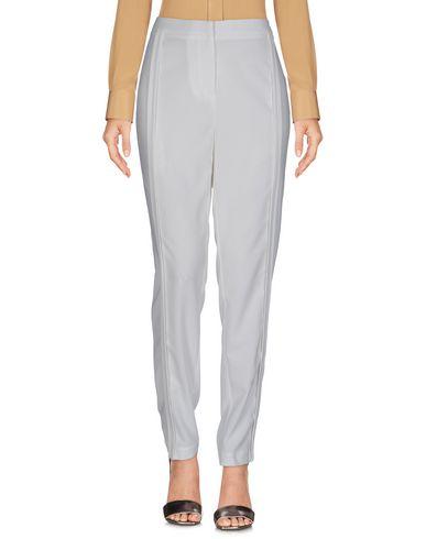 Фото - Повседневные брюки от TY-LR белого цвета