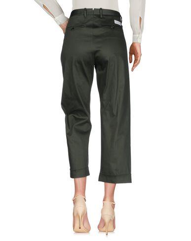 Фото 2 - Повседневные брюки от NINE:INTHE:MORNING темно-зеленого цвета