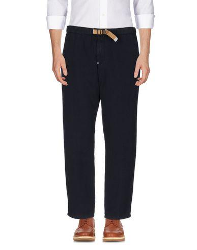Фото - Повседневные брюки от WHITE SAND 88 темно-синего цвета