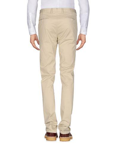 Фото 2 - Повседневные брюки от GTA IL PANTALONE бежевого цвета