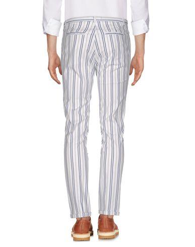 Фото 2 - Повседневные брюки от PAUL MIRANDA белого цвета