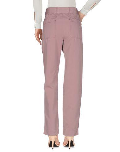 Фото 2 - Повседневные брюки пастельно-розового цвета