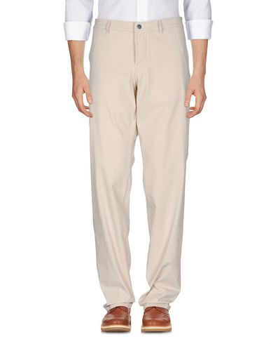 Фото - Повседневные брюки от THINPLE бежевого цвета