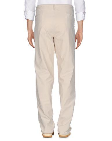 Фото 2 - Повседневные брюки от THINPLE бежевого цвета