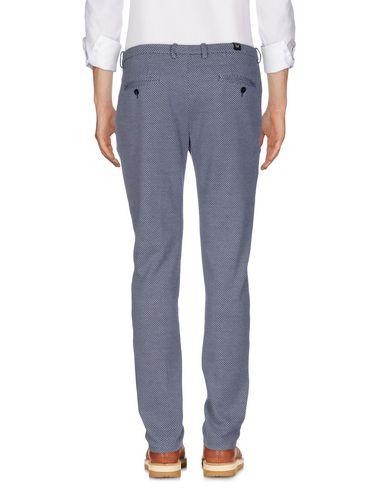 Фото 2 - Повседневные брюки от OBVIOUS BASIC темно-синего цвета