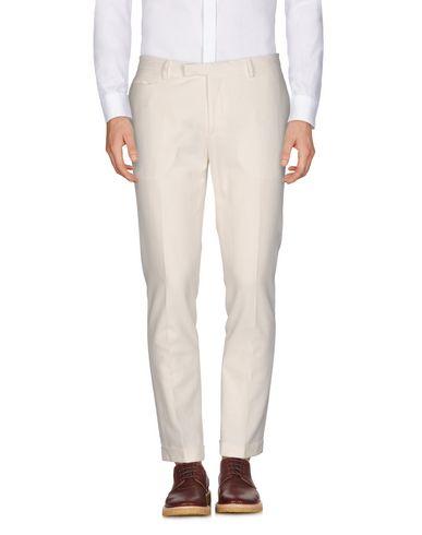 Купить Повседневные брюки от BRIAN DALES белого цвета