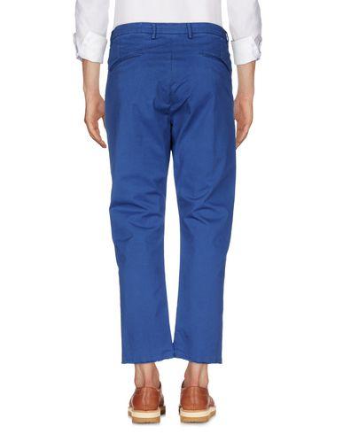 Фото 2 - Повседневные брюки от PENCE синего цвета