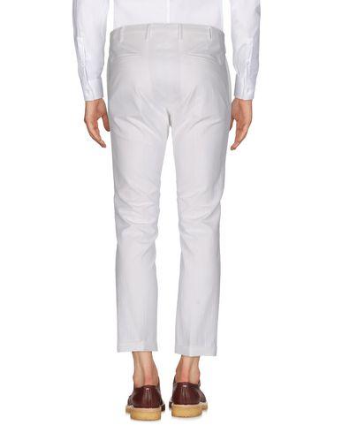 Фото 2 - Повседневные брюки от PT01 GHOST PROJECT белого цвета