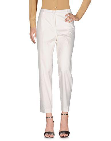 Фото - Повседневные брюки от QL2  QUELLEDUE белого цвета