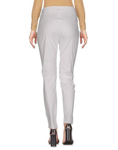 Фото 2 - Повседневные брюки от MALÌPARMI белого цвета