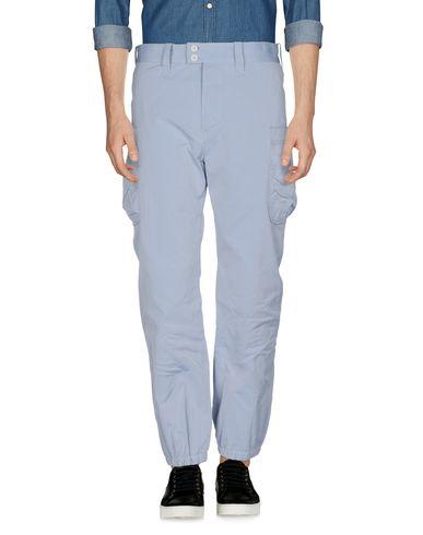 Фото - Повседневные брюки от TS(S) светло-серого цвета