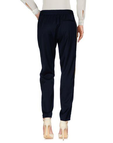 Фото 2 - Повседневные брюки от PALM ANGELS темно-синего цвета