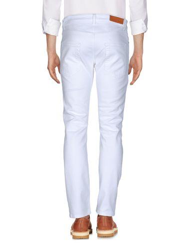 Фото 2 - Повседневные брюки от PAURA белого цвета