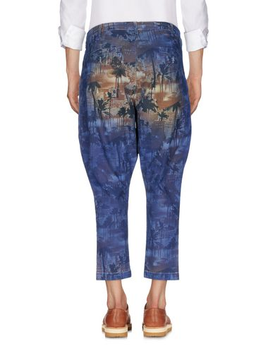 Фото 2 - Повседневные брюки от NEILL KATTER темно-синего цвета