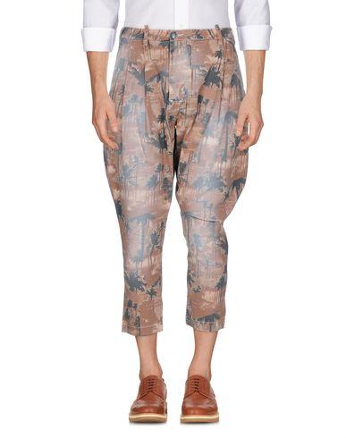 Фото - Повседневные брюки от NEILL KATTER светло-коричневого цвета