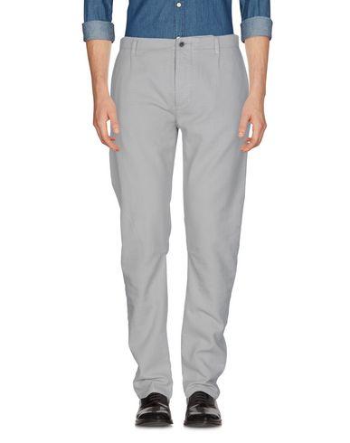 Фото - Повседневные брюки от CRUNA светло-серого цвета
