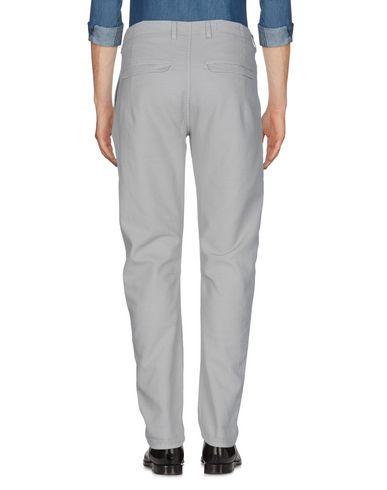 Фото 2 - Повседневные брюки от CRUNA светло-серого цвета