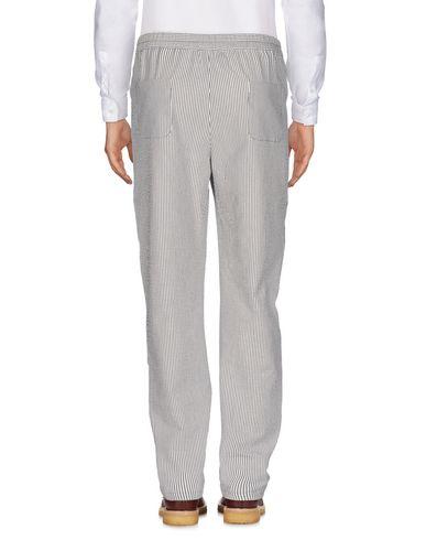 Фото 2 - Повседневные брюки от BIG UNCLE белого цвета