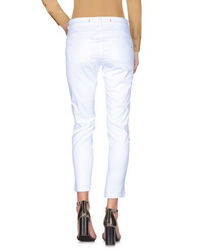 Фото 2 - Повседневные брюки от 19.70 NINETEEN SEVENTY белого цвета
