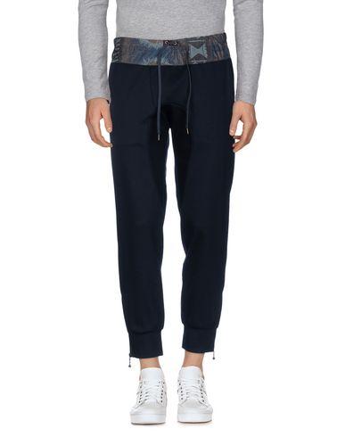 Фото - Повседневные брюки от KOLOR темно-синего цвета