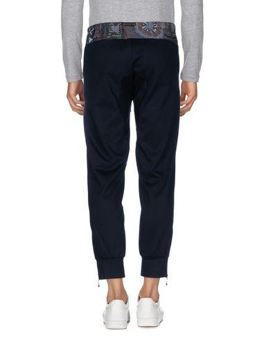 Фото 2 - Повседневные брюки от KOLOR темно-синего цвета