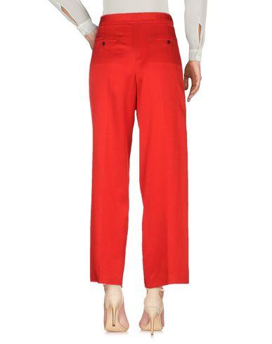 Фото 2 - Повседневные брюки от FORTE_FORTE красного цвета