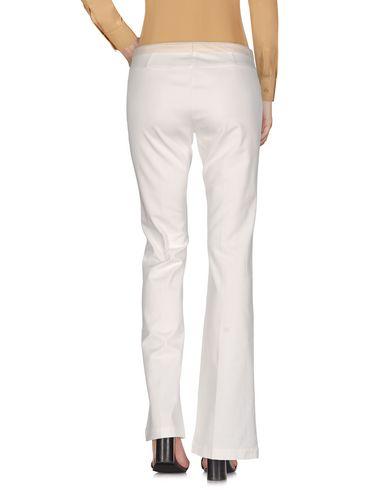 Фото 2 - Повседневные брюки от TERESA DAINELLI белого цвета