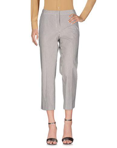 Фото - Повседневные брюки от KILTIE белого цвета